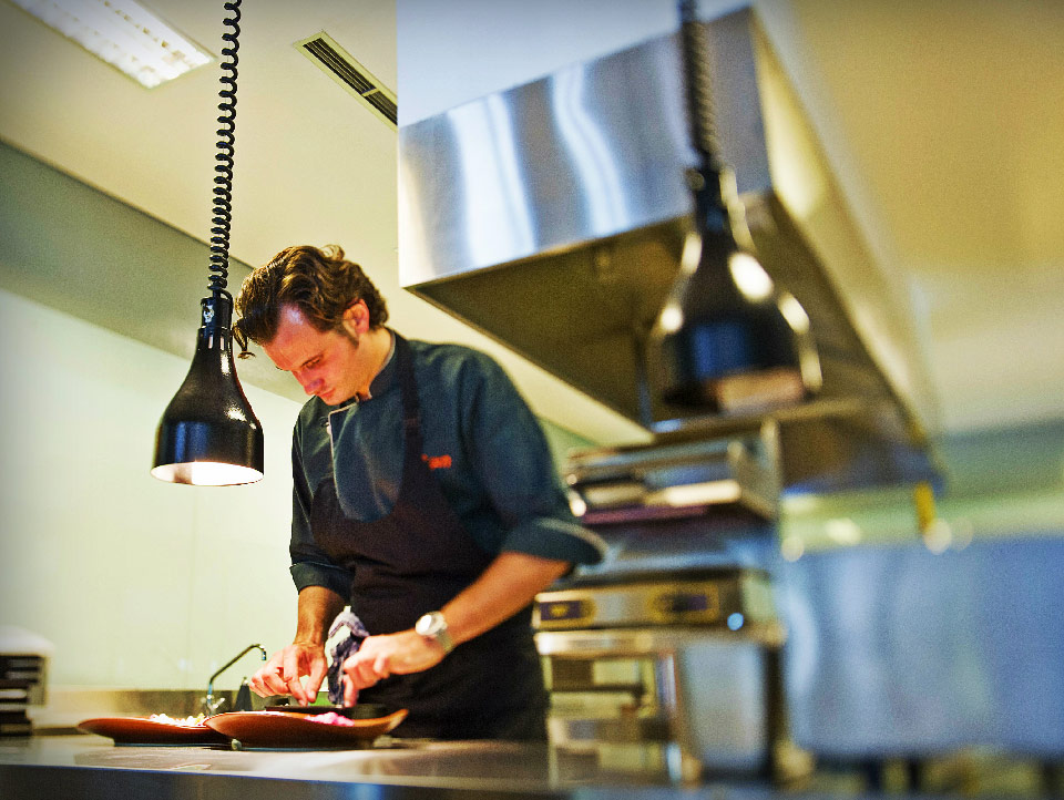 Chef Kevin is preparing meals for customers at the best casual and outdoor dining restaurants in Bali