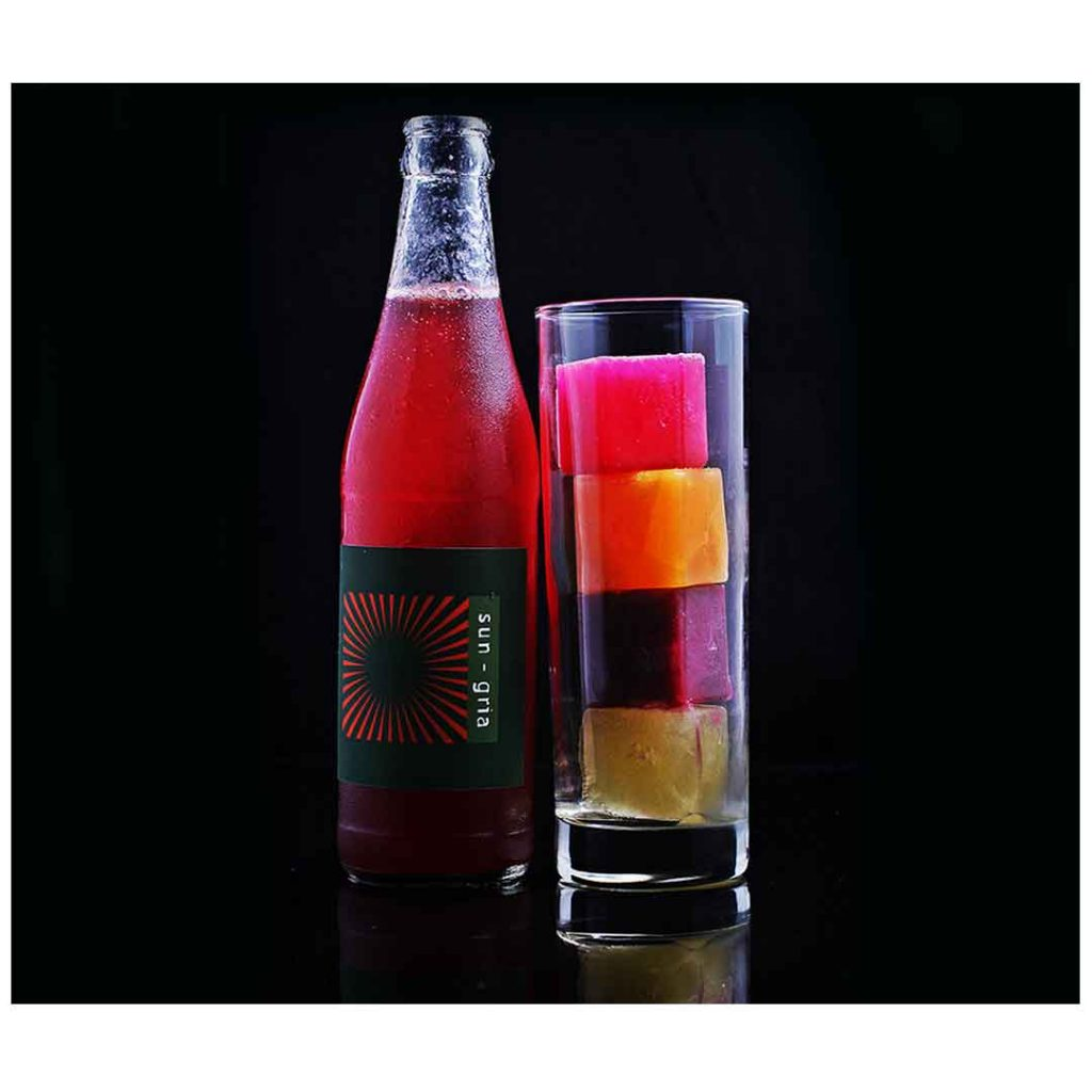 a restaurant in Bali presents Sungaria drink in the bottle and glass