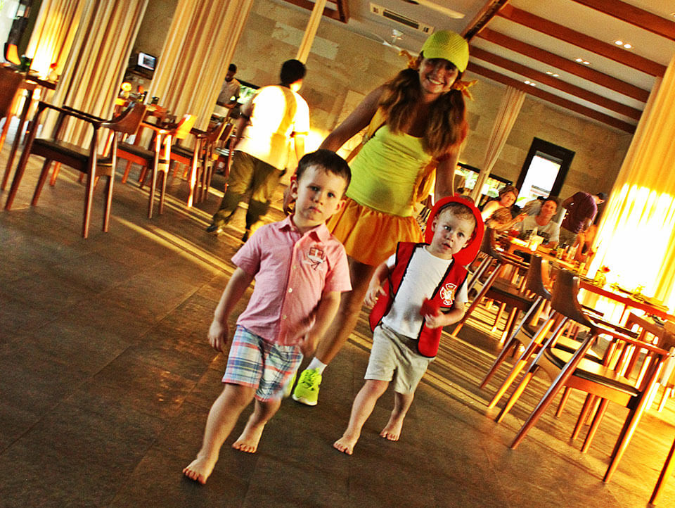 A lady with her two boys visiting Cuca Bali restaurant